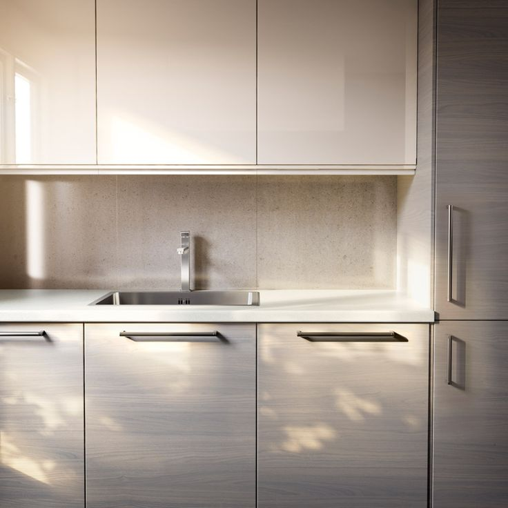 FAKTUM kitchen with SOFIELUND light grey walnut effect doors/drawers and ABSTRAKT yellow-white high-gloss doors