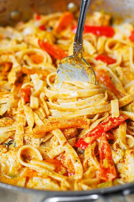 Mexican Chicken Pasta  Sliced chicken cooked in Mexican spices, with bell peppers and green chiles, in a creamy sauce made with Cheddar and Mozzarella cheese and spices.