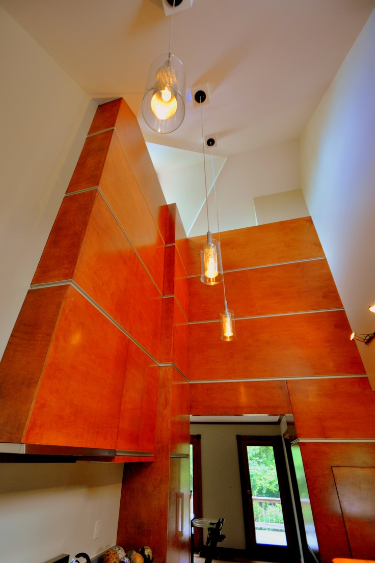 existing vaulted space opened and transformed with material, line and light.  photo by Jeff DuBro