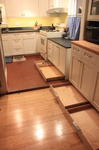 Under Kitchen Cabinet Storage Ideas toe kick drawers. awesome idea for the unused space under your