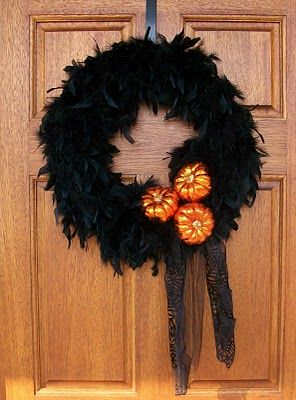 For inspiration. Make this except use chocolate brown boas (in the fall seasonal isle in hobby lobby). Use the three pumpkins and some brown velveteen lace ribbon with orange trim. Hang the words Give Thanks across the middle orange and glittered letters (again at HL).