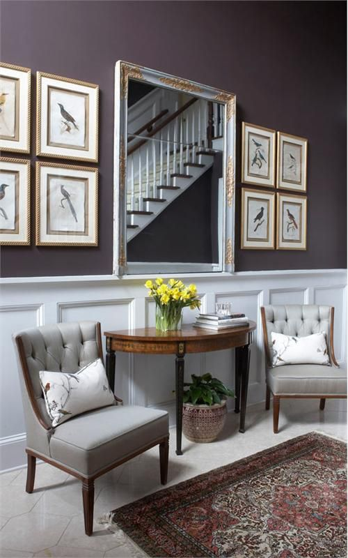 Nice wainscoting and seating area in this entryway for Foyer seating area ideas