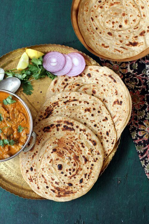 Lachha paratha, a crisp, flaky, multi layered North Indian flat bread prepared with whole wheat flour or atta #paratha #indianfood