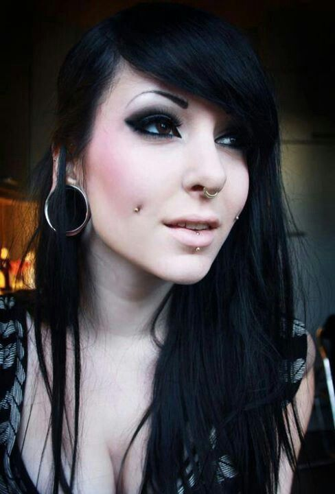 Dark makeup septum rings, cheek piercings, lebret, ear tunnels
