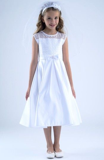 Free shipping and returns on Us Angels First Communion Dress (Little Girls & Big Girls) at Nordstrom.com. A sweet lace bodice overlay and a hand-beaded bow at the waist detail an enchanting First Communion dress in lustrous satin.