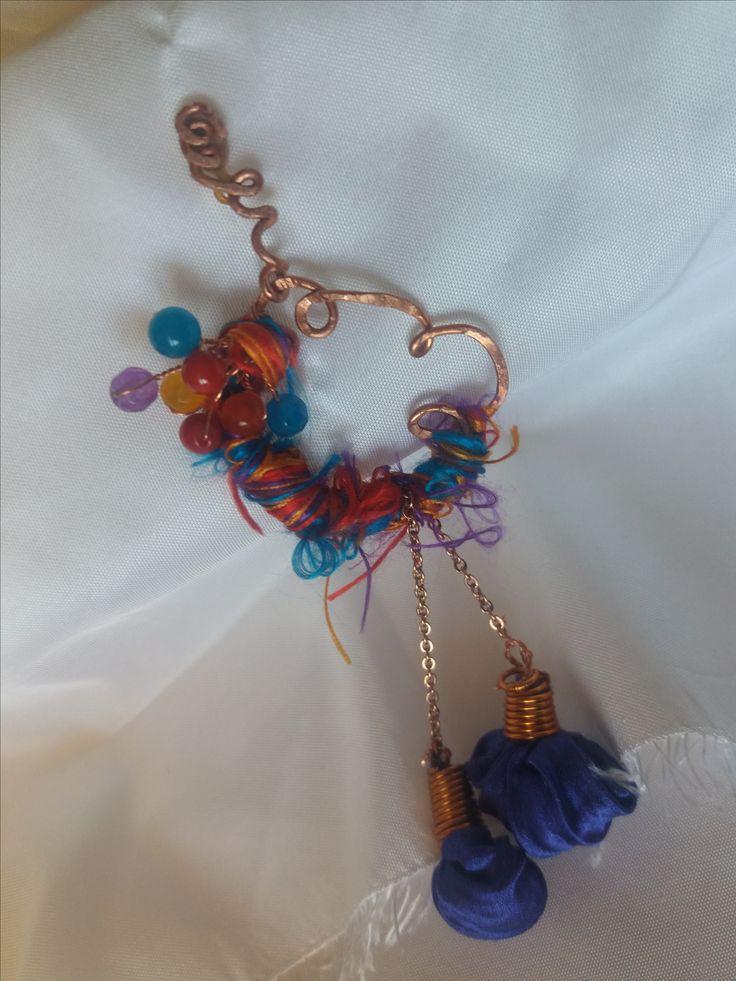 Cod-351 Mauve shibori silk ornaments adorning a copper body and decorated with earth-mined semi-precious stones.  https://www.facebook.com/Crown-Art-Jewelry-685629774912291