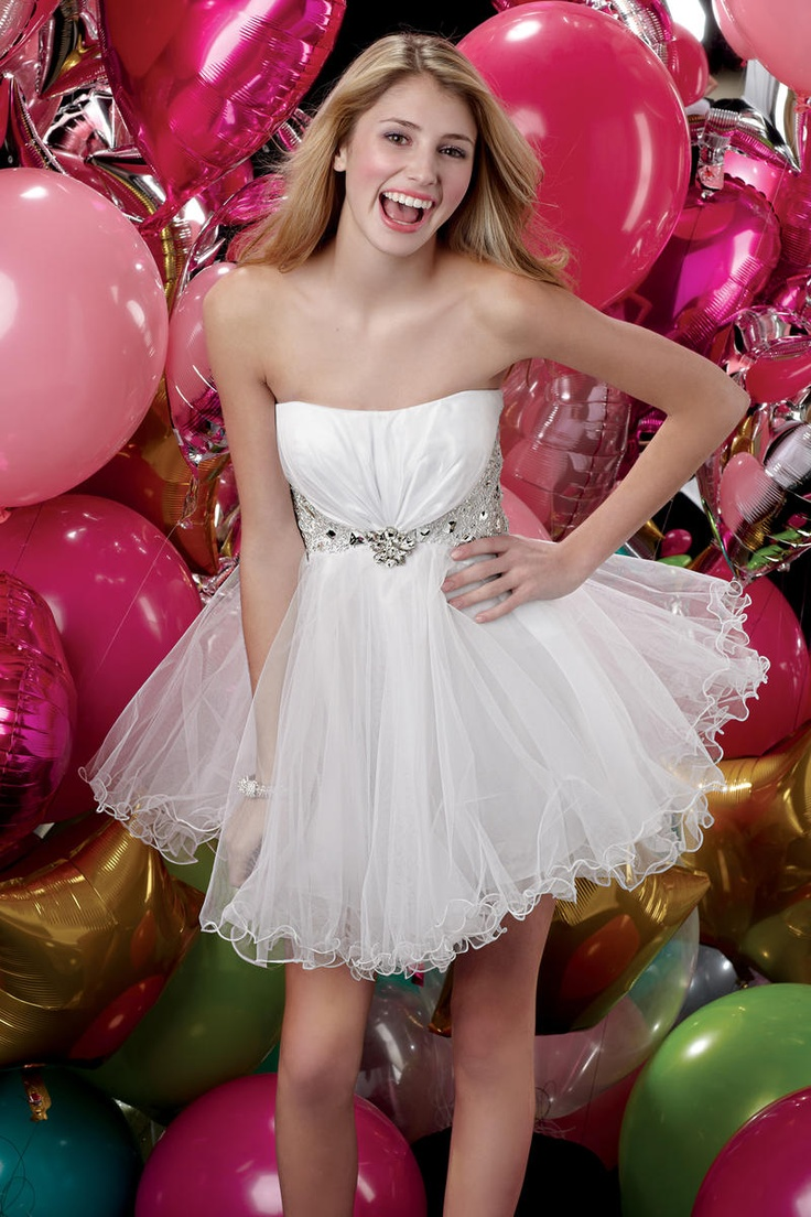 prom dresses 2013 Look simple yet sweet in this short dress from Alyce. Details include full tulle skirt, strapless neckline, and stone flower under center of bustline. Silver beadwork and stones under bodice extend around the back.