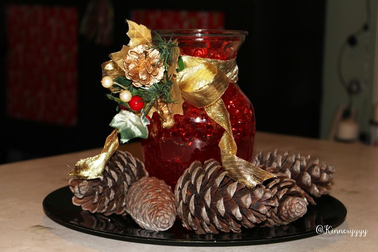 Christmas holiday centerpiece decor gold green red ribbon pine cones
