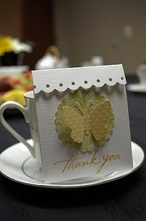 favors for a tea party baby shower. A tea bag is tucked inside each adorable little package