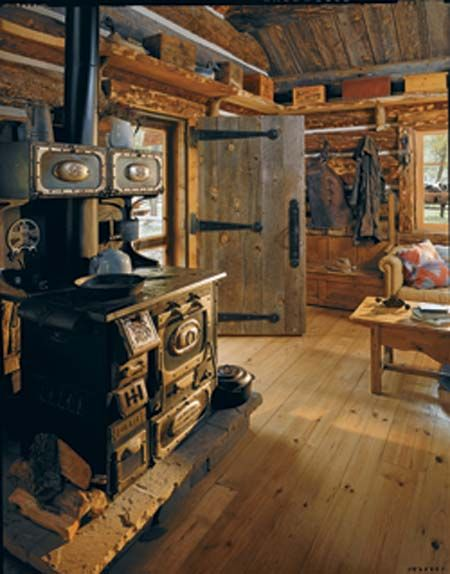 Log Cabin Living...love the stove!