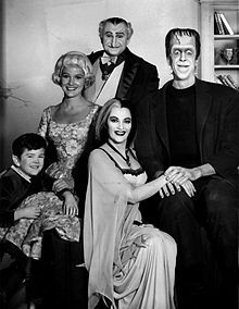 1964 photo of the cast of The Munsters.  (Herman Munster played by Fred Gwynne has the iconic design of Frankenstein's Monster)