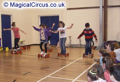 Wade Deacon High School children on pedal goes during the circus skills workshop demonstration.   MagicalCircus.co.uk