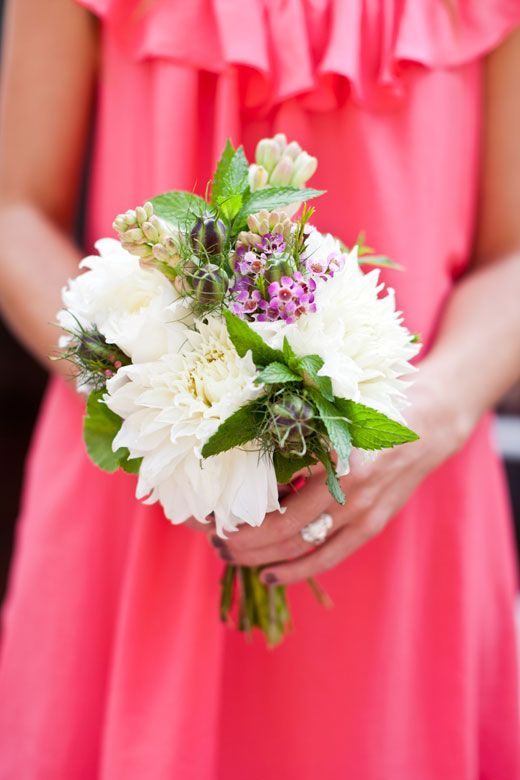 Bouquet of watermelon dahlias, white dahlias, geranium foliage, tuberose, pink wax flower, and fresh mint. Created by April Peet of
