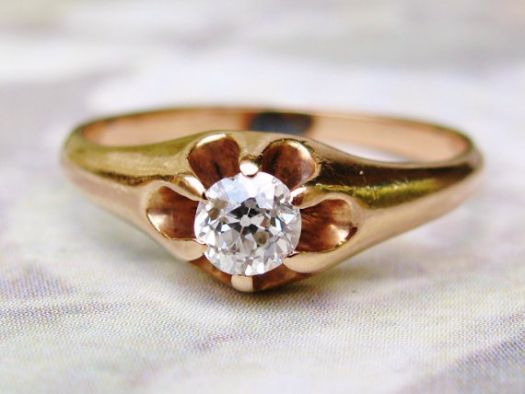"""This is an antique design circa 1900s called a Belcher setting or """"buttercup"""" with the six 14K yellow gold prongs holding up the old European cut diamond in a fashion that the name implies. Description from etsy.com. I searched for this on bing.com/images"""