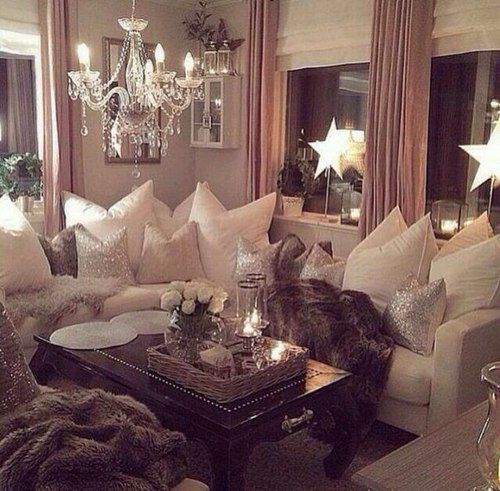 Love the chandelier, fur throws, and all the pillows.