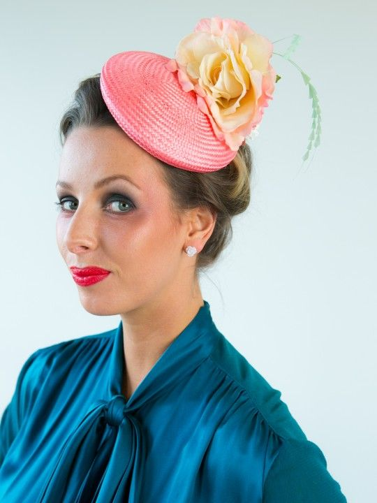LITTLE MISS LUKE | Hat/Fascinator for Oaks Day | FORD MILLINERY  $330  Little Miss Luke loves her high tea, and you will never see her underdressed. A dusty pink beret style base made of shimmering buntal straw. A large pastel apricot rose with dusty pink edges sits high atop the button's edge, whilst a collection of small white silk roses hides behind it. A sprig of mint sculpted feathers is the perfect garnish for Little Miss Luke's high tea.