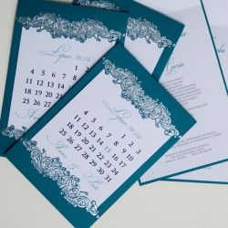 An invitation from the newest collectionresemble calendar. The cover is made fromturquoise-coloured paper with  hot stamped silver decorative motifs. The matte insert for printing text is white in colour. We send the invitations in a form that is ready to be handed to the guests. An invitation made with great care and attention to detail.