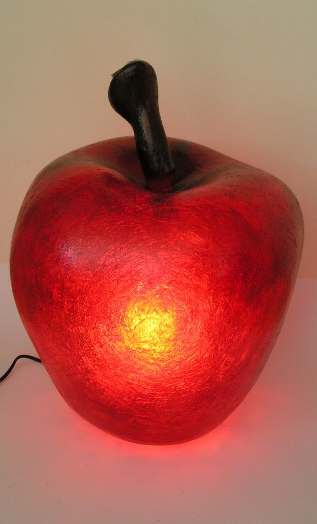 Lighting fixture in the shape of an apple, made out of fiberglass. It can be put on the floor or on any surface, even on carpeted or wooden floor.  Dimensions: 50 x 35cm  Fiberglass material is robust and unbreakable, at the same time as being very light -almost weightless.  It is ideal for any room. It can be used as a stylish night-light, or just decorate and brighten the space at any time.  Freshness, guaranteed!