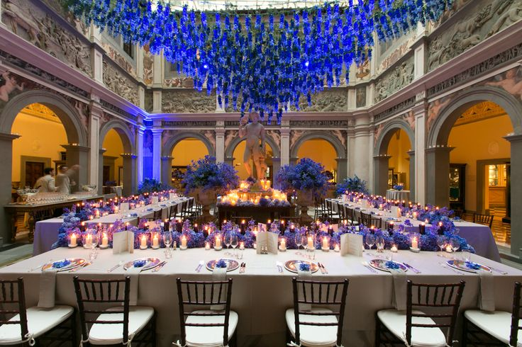 Blue wedding dinner set up, blue hydrangea centerpiece runner, blue delphinium hanging from the ceiling