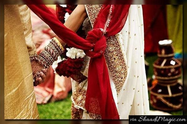 The Sign Of Equality, Togetherness & Faith.  For the eternal bond and pledge before the holy, sacred fire, both the bride and groom have to wear the scarves.