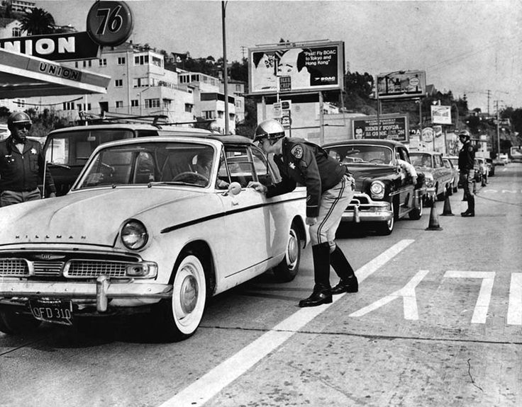 A holiday traffic check by California Highway Patrol officers on Sunset Blvd. near Sunset Plaza in 1965. (LAPL 00044613) Bizarre Los Angeles