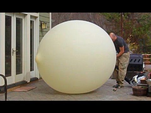 Crazy Russian Hacker Over-Inflates a 40′ Weather Balloon & Films It Bursting in Slow Motion