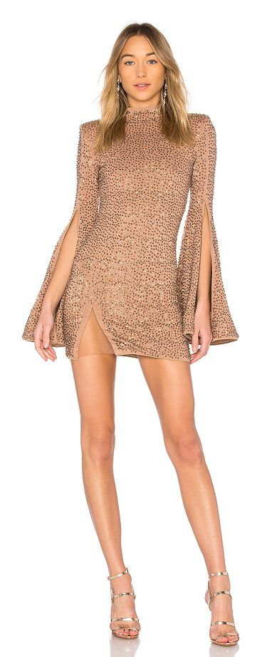 x REVOLVE Mr. Gibson Mini Dress by Michael Costello. Self: 90% rayon 5% poly 5% spandexLining: 90% poly 10% spandex. Hand wash cold. Fully lined. Padded shoulders. Bead and sequin embellishments throughout. Sheer mesh front slit. Hidden back zipper closure. MELR-WD9. MCD3 H17. #michaelcostello #dresses
