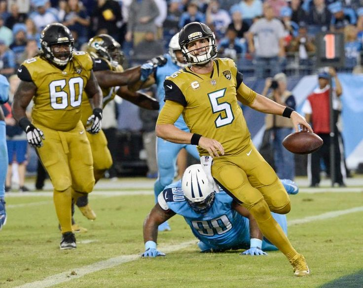 Thursday Night Football: Jaguars vs. Titans:    October 27, 2016  -  36-22, Titans   -     Jacksonville Jaguars quarterback Blake Bortles (5) scores a 2-point conversion ahead of Tennessee Titans defensive lineman DaQuan Jones (90) in the second half of an NFL football game Thursday, Oct. 27, 2016, in Nashville, Tenn.