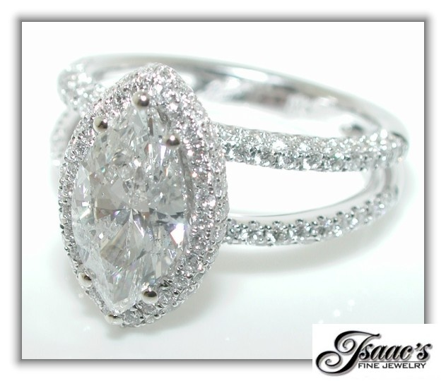 Marquise diamond ring with halo and split shank band. Very pretty!