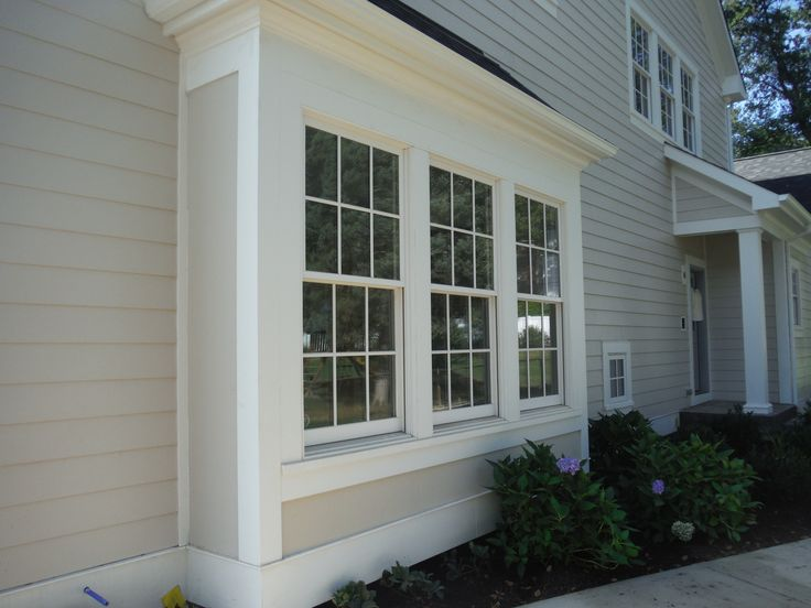 Picture of window upfront with Board & Batten Cobblestone Siding.