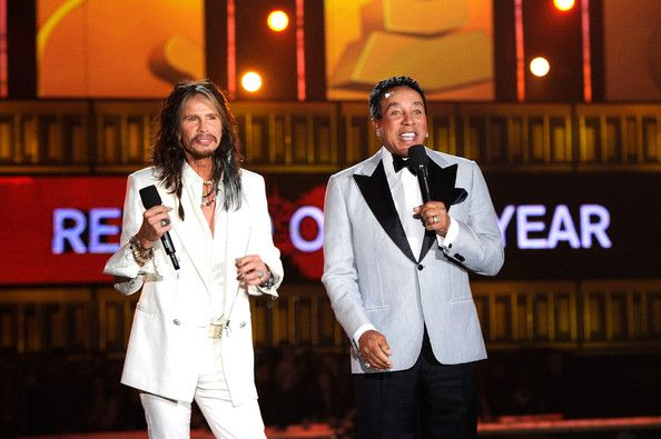Steven Tyler and Smokey Robinson speak onstage during the 56th GRAMMY Awards at Staples Center on January 26, 2014 in Los Angeles, California. - The 56th Grammy Awards Show