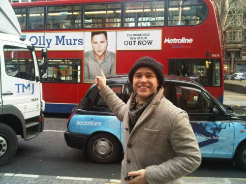 He looks so excited to see himself on a Big Red Bus -D