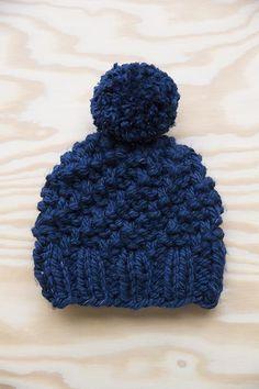 Donkerblauwe kindermuts Lumio met pompon | Veritas BE