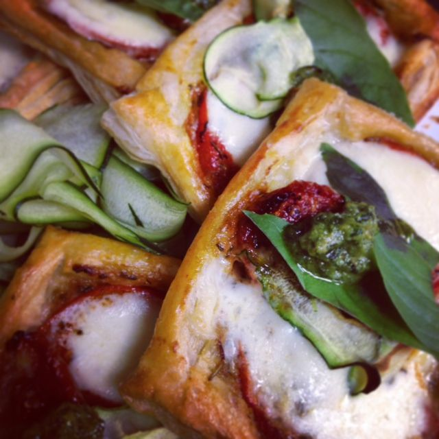Sun dried and roasted tomatoes tarts  with mozzarella, pesto and courgette ribbon