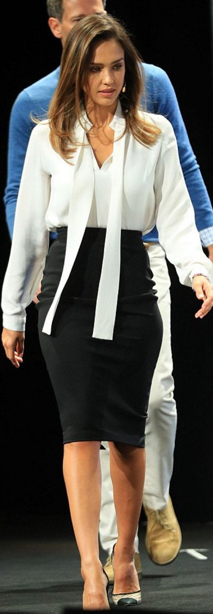 Who made  Jessica Alba's black skirt, black handbag, white long sleeve top, and cap toe pumps?
