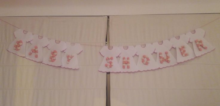 Letrero Baby Shower con flores en tonos pasteles
