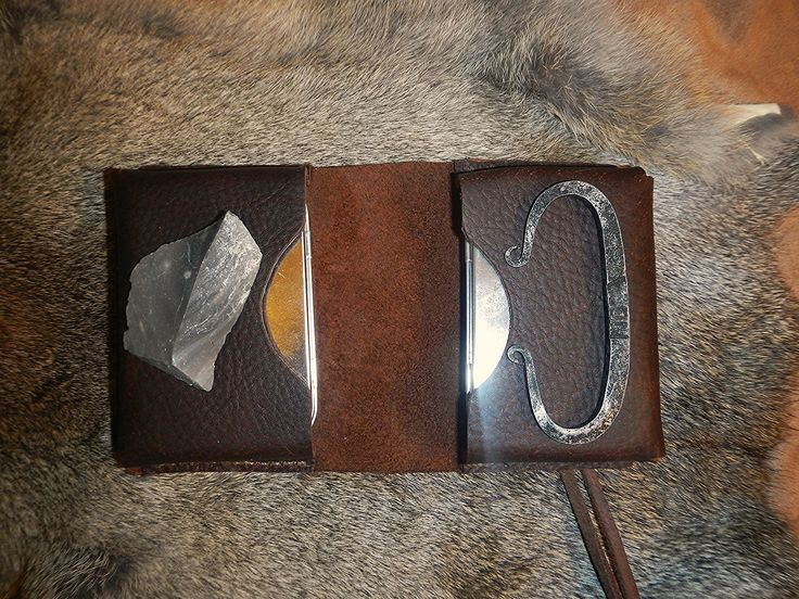 Leather tin pouch with Strike A Light Flint and steel kit. Includes two altoids size tins and a Stike A Light Flint and Steel Kit.