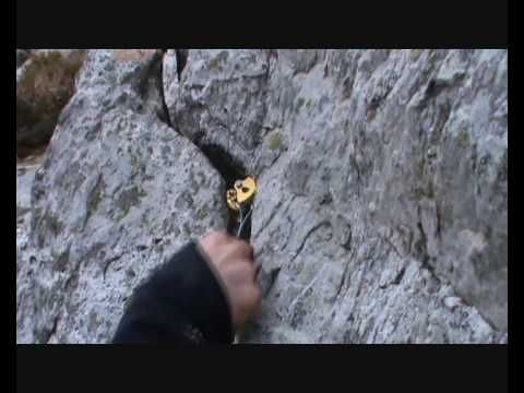 Using rock features and placing protection when building climbing anchors