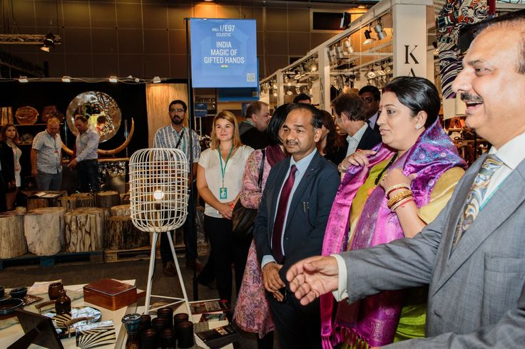 """Hon'ble Union Minister of Textiles Smt. Smriti Zubin Irani felicitated at EPCH pavilion """" India Magic of Gifted Hands """" — in Paris, France."""