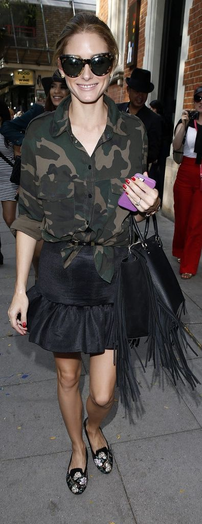 During Fashion Week, Olivia contrasted her camo button-down with her oversize tortoiseshell Zanzan sunglasses and — yes — flats! And while she still added a dose of fringe with her statement satchel, it was also roomy and functional.