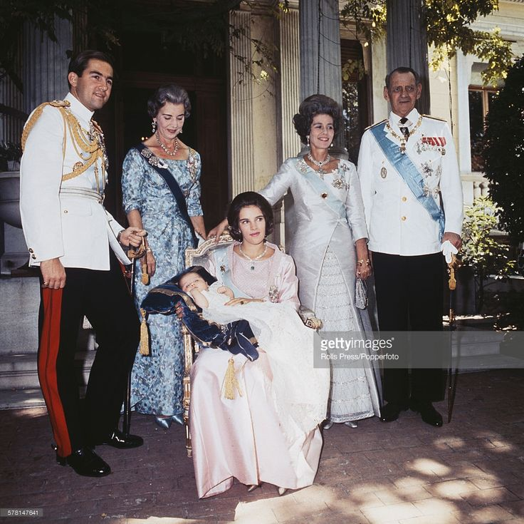 Group portrait of members of the Greek royal family at the christening of Princess Alexia of Greece and Denmark in 1965. From left to right: King Constantine II of Greece, Ingrid of Sweden, Queen Anne-Marie of Greece holding Princess Alexia of Greece and Denmark, Frederica of Hanover and Frederick IX of Denmark.