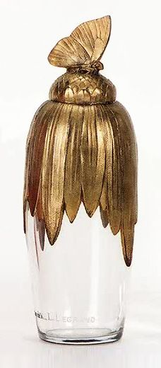 Baccarat Crystal Perfume Bottle :: A gilt ormolu flower cover with a butterfly finial with its original glass stopper, engraved with the seller's name on the side, Oriza L. LeGrand and the maker's name underfoot, Baccarat, France