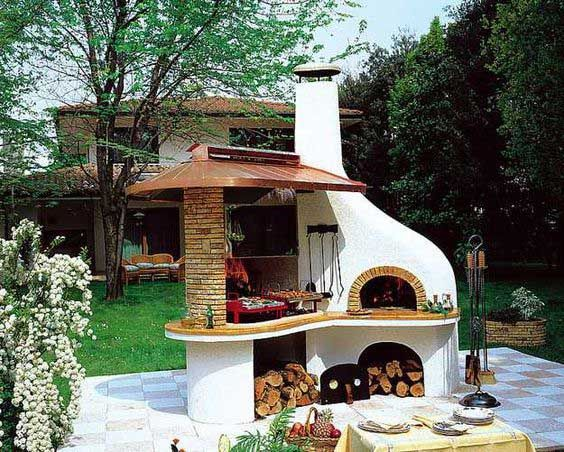 So cool outdoor kitchen with wood-fired oven.