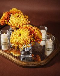 Light up a table with this sand-and-shell centerpiece.