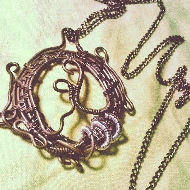 Wire wrapped cooper pendant with silver detail and cooper necklace.