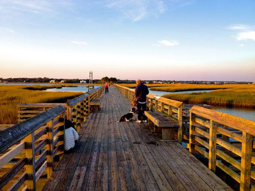Take in the beauty of Charleston from a wooden bridge in nearby Mount Pleasant.