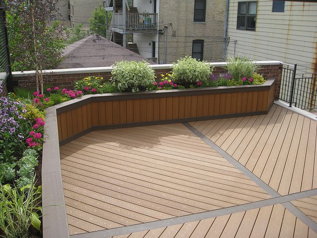 DeckScaping / Built In Deck Planter Filled With Shrubbery And Flowers.  Plantings Can Be Adjusted