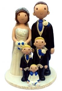 Family wedding cake topper, love that all the children were included and in matching outfits #wedding