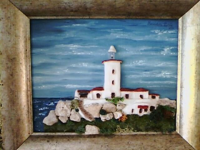My sculpture ot the light house in Mossel bay. It has a real burning light in the tower.