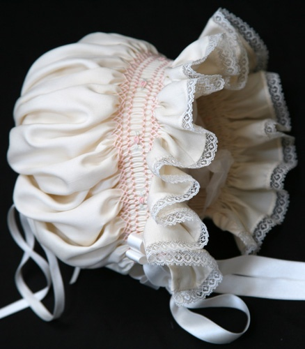 smocked baby bonnet...it's been so long since my girls were little & I used any of the pleating machines...wonder if it all would be like riding a bicycle...it would just come back to you? Remember all the smocking part...would be interesting threading the pleater after all these years :)